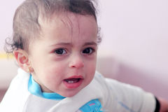 Baby girl crying. Portrait of arabian egyptian baby girl crying and feeling sad Royalty Free Stock Photos