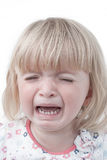 Baby girl crying. Crying baby girl Portrait on a white background Stock Image