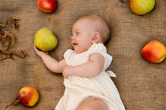 Baby girl. Cute baby girl with apples Royalty Free Stock Image