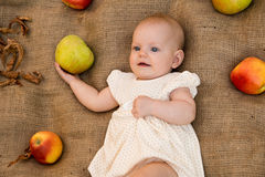 Baby girl. Cute baby girl with apples Stock Photography