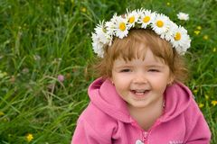 Baby girl with daisy wreath stock photo