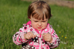 Baby girl with dandelion Royalty Free Stock Images