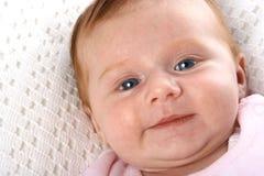 Baby girl with deep blue eyes Stock Photos
