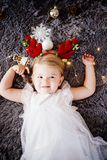 Baby girl with deer horns. royalty free stock photos