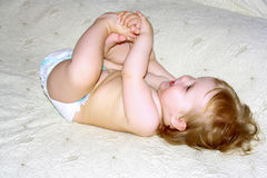 Baby girl in diaper Stock Photography