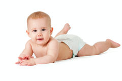 Baby girl in diaper lying. Studio shot Royalty Free Stock Photography