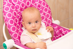 Baby girl after dinner Royalty Free Stock Photos