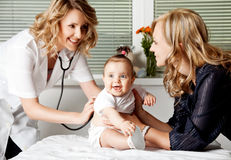 Baby girl doctor Stock Images