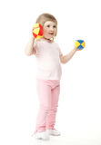 Baby girl doing exercises with toy dumbbells Stock Images