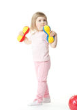 Baby girl doing exercises with toy dumbbells Stock Photo