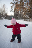 Baby Girl Doing First Steps in Snow Stock Image