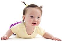 Baby girl doing tummy time Stock Photos