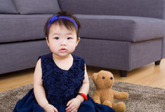Baby girl and doll bear royalty free stock photography