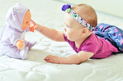 Baby girl with doll royalty free stock photos