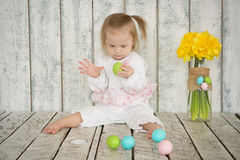 Baby Girl with Down syndrome is holding Easter eggs Royalty Free Stock Photo