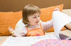 Baby girl drawing Stock Photography