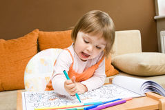 Baby girl drawing royalty free stock images