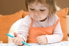Baby girl drawing royalty free stock image