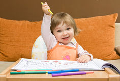 Baby girl drawing Royalty Free Stock Photography