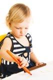 Baby girl drawing Stock Image
