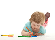 Baby girl drawing with colorful felt-tip pens Royalty Free Stock Photography
