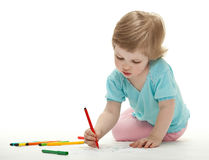 Baby girl drawing with colorful felt-tip pens. On white background stock images