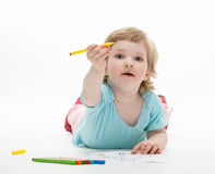 Baby girl drawing with colorful felt-tip pens Royalty Free Stock Images