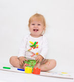 Baby girl drawing picture with paints Stock Photos