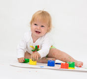 Baby girl drawing picture with paints Royalty Free Stock Image