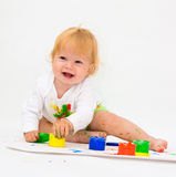 Baby girl drawing picture with paints Royalty Free Stock Images