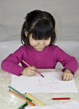 A Baby girl is drawing pictures Royalty Free Stock Photo