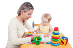 Baby Girl Drawing With Her Mother Royalty Free Stock Photo