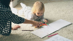 Baby girl draws a picture with pencils stock video footage