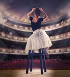 Baby girl dreaming a dancing ballet on the stage. Childhood concept. Stock Images
