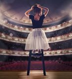 Baby girl dreaming a dancing ballet on the stage. Childhood concept. Royalty Free Stock Photos