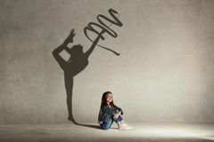 Baby girl dreaming about gymnast profession. Childhood concept. Baby girl dreaming about gymnast profession. Childhood and dream concept. Conceptual image with royalty free stock images