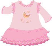 Baby girl dress. Pink baby girl dress with frills and with picture of bird Royalty Free Stock Photography