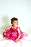 Baby girl in dress. Baby girl in pink dress Stock Images