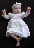 Baby girl in a dress Stock Photo