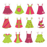 Baby Girl Dress Collection. Collection of baby girl dresses, isolated over white Royalty Free Stock Photos