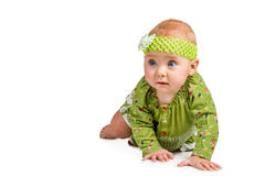 Baby girl in a dress crawling Royalty Free Stock Photo