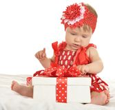 Baby girl in   dress  with gift Stock Image