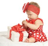 Baby girl in   dress  with gift Royalty Free Stock Images