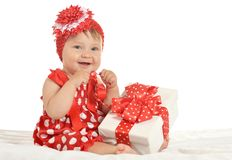 Baby girl in   dress  with gift Stock Images