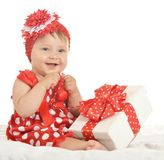 Baby girl in   dress  with gift Royalty Free Stock Image