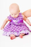 Baby girl in a dress. studio Stock Image
