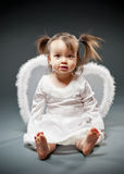 Baby girl dressed as an angel Stock Photos