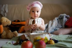 Little cook holding a spoon royalty free stock image