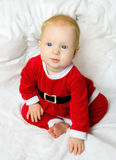 Baby girl dressed as Santa Claus Royalty Free Stock Photos