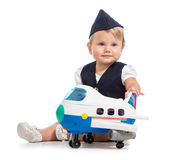 Baby girl dressed as stewardess with air plane toy Stock Images